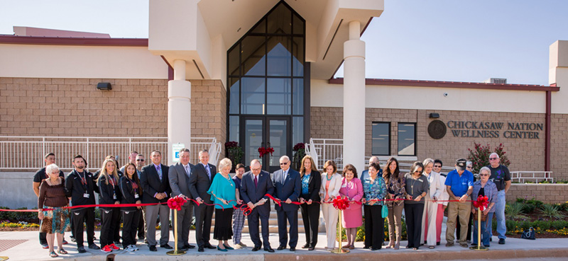 Chickasaw Nation Governor Bill Anoatubby, center with large scissors, leads ribbon cutting ceremonies to officially open the Chickasaw Nation Purcell Area Service Center, Thursday, Sept. 14. The campus, located at 1438 Hardcastle Boulevard, includes a new Chickasaw Nation Wellness Center, an expansion of the Chickasaw Health Clinic, new Purcell Area Office.